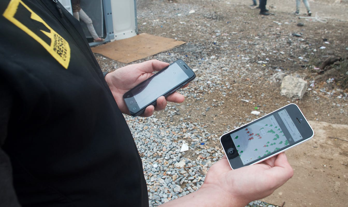 An IRC field worker accesses Refugee.Info from a smartphone.