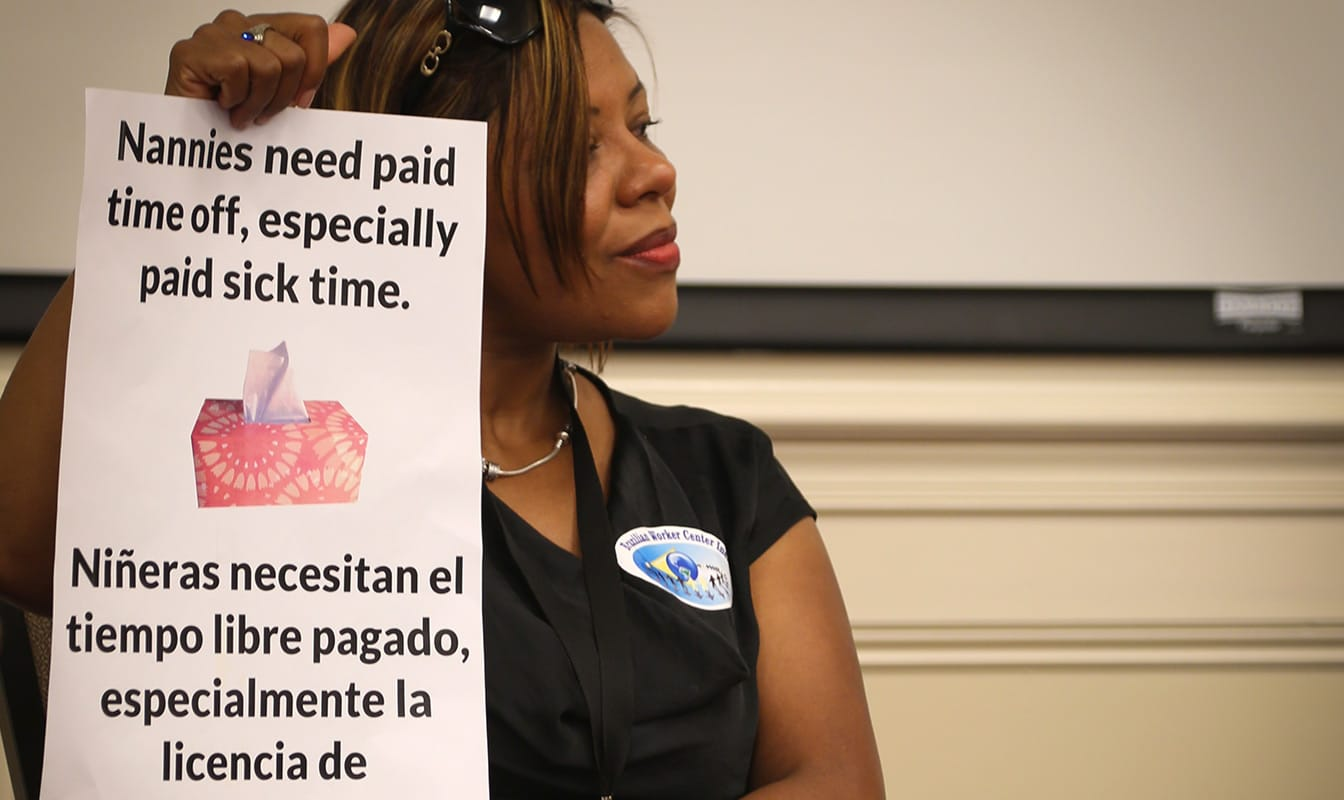An NDWA member advocates for labor protections for domestic workers